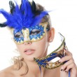 Foto Stock: The beautiful girl in carnival mask