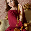 The elegant sensual young woman in a claret dress — Photo