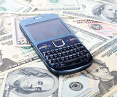 Cellular phone on dollars — Foto Stock