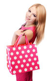 Pretty woman with shopping bags isolated on white — Stock Photo