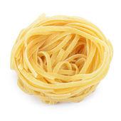 Italian pasta tagliatelle nest isolated on white background — Stock Photo