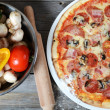 The Italian pizza with a ham and mushrooms — Stock Photo #26300055