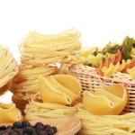 Italian pasta tagliatelle nest isolated on white background — Stock Photo #27551101