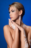 Beautiful woman with bodyart on hands — Stock Photo