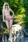 The beautiful woman the blonde in bikini — Stok fotoğraf