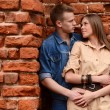 Young enamoured pair brick wall — Stock Photo #28323783