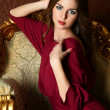 Stock Photo: Elegant sensual young womin claret dress
