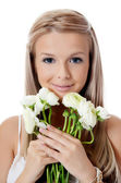 Girl with beautiful hair with flower — Stock Photo