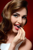 The beautiful woman with sweet cherry — Stock Photo