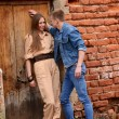 Young enamoured pair brick wall — Stock Photo #31087999