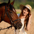 The woman on a horse in the field — Stock Photo #31088153