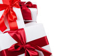 Box with a gift with a red tape — Stock Photo