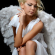 The beautiful girl in a suit of a white angel — Stock Photo