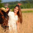The woman on a horse in the field — Stock Photo #32958759