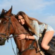 The woman on a horse against the sky — Stock Photo #32959051