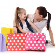 Mom and daughter with lot packages with shopping — Stock Photo #32959223