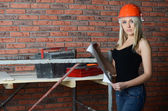The woman in a building helmet look the project — Stockfoto