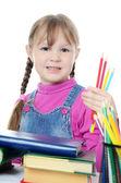 Het kleine meisje leren geïsoleerd op witte achtergrond — Stockfoto