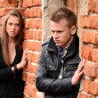 The man and the woman against a brick wall — Stock Photo