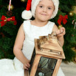 Little girl at christmas fur-tree — Photo #33423949