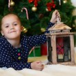 Little girl at christmas fur-tree — Stockfoto #33424049