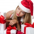 The Christmas girl with boxes of gifts — Stock Photo