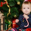 The little girl at a Christmas fur-tree with gifts — Стоковая фотография