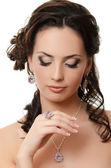 The beautiful woman with expensive jewelry — Stock Photo