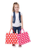 The little girl with two packages isolated — Stock Photo
