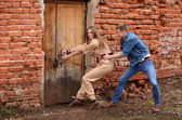 The man and the woman open a wooden door — Stock Photo