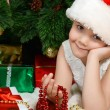 Little girl at christmas fur-tree — стоковое фото #34350593