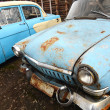 The old rusty car — 图库照片
