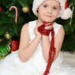 Little girl at christmas fur-tree — стоковое фото #34350809