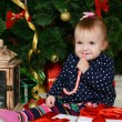 The little girl at a Christmas fur-tree with gifts — Stock Photo