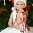 Little girl at christmas fur-tree — Stockfoto #34350901