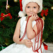 Foto de Stock  : Little girl at christmas fur-tree