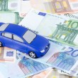 Stock Photo: The toy car for euro banknotes as a background