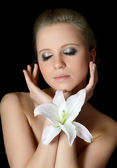 The beautiful woman with lily flower — Stock fotografie