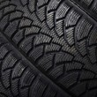 The automobile tire on black background — Stock Photo