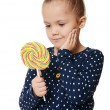 Stock Photo: The little girl with lollipop