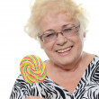 The elderly woman with sugar candy — Stock Photo