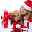 The Christmas girl with boxes of gifts  — Stockfoto