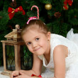 Stockfoto: Little girl at christmas fur-tree