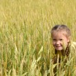 The little girl in wheaten field — Stock Photo