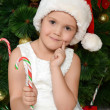 Little girl at christmas fur-tree — Photo #35247053