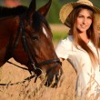 Stock Photo: The woman on a horse in the field