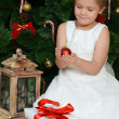 The little girl at a Christmas fur-tree with gifts — Stock Photo #35247301