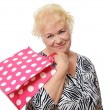 The elderly woman with a package — Lizenzfreies Foto