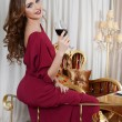The elegant woman with a wine glass at smart restaurant — Foto de Stock