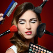 The beautiful girl with brushes for make-up — Stock Photo